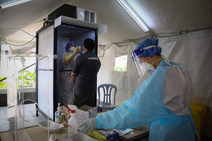 a health worker inside a protective
