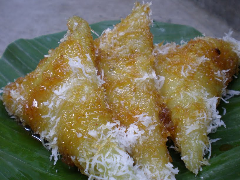 Sticky Rice Rolls served with Palm Sugar Syrup (Lupis)