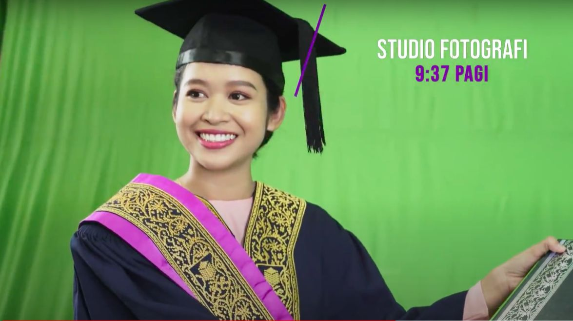 Students with green screen backdrop